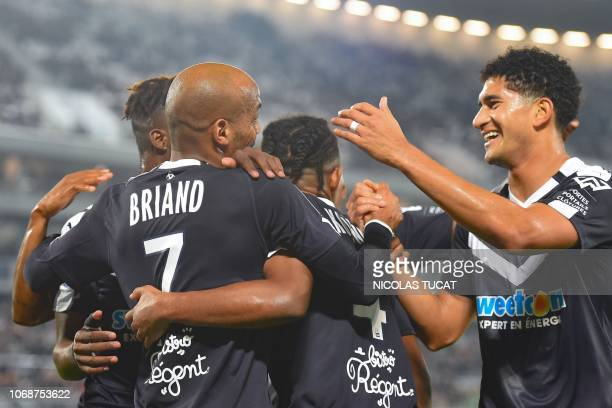 Bordeaux's French forward Jimmy Briand celebrates with teammtes after scoring a goal during the French L1 football match between FC Girondins de...