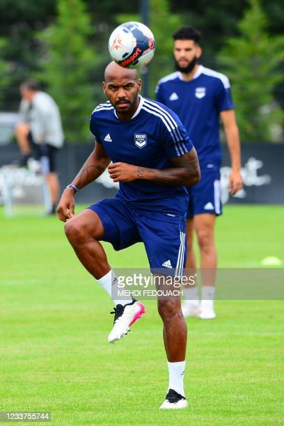 Bordeaux's French forward Jimmy Briand heads the ball as Girondins de Bordeaux's team takes part in a training session in Le Haillan, near Bordeaux,...