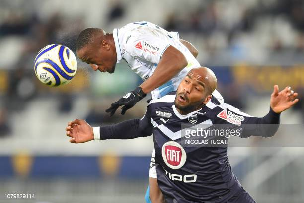 Bordeaux's French forward Jimmy Briand vies with Le Havre's defender Fernand Mayembo during the French League Cup quarter final football match...