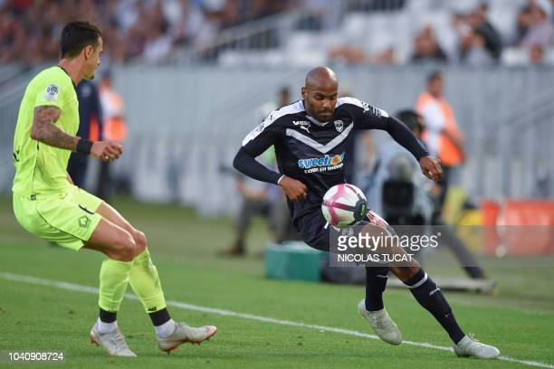 Bordeaux's French forward Jimmy Briand vies with Lille's Portuguese defender Jose Miguel Fonte during the French L1 football match between Bordeaux...