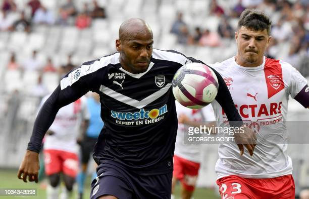 Bordeaux's French forward Jimmy Briand vies with Nîmes' French defender Anthony Briancon during the French L1 football match between FC Girondins de...