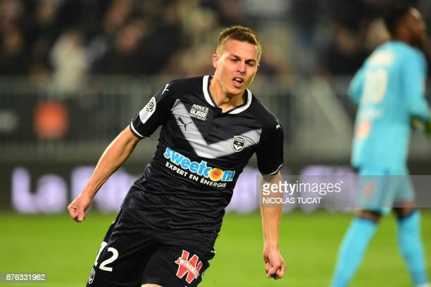Bordeaux's French forward Nicolas De Preville celebrates after scoring a goal during the French L1 football match between Bordeaux and Marseille on...