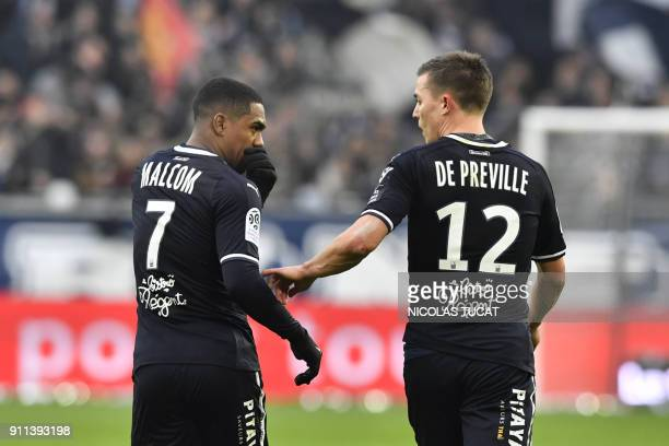 Bordeaux's French forward Nicolas De Preville celebrates with Bordeaux's Brazilian forward Malcom after scoring a goal during the French Ligue 1...