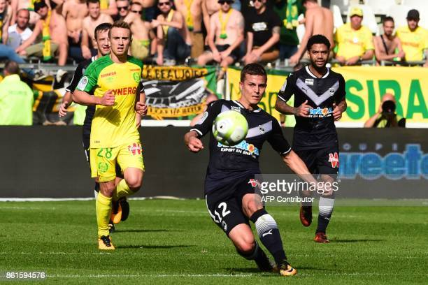 Bordeaux's French forward Nicolas De Preville kicks the ball during the French Ligue 1 football match between Bordeaux and Nantes on October 15 2017...