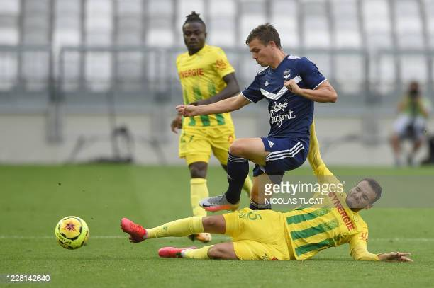 Bordeaux's French forward Nicolas De Preville vies with Nantes' midfielder Pedro Chirivella during the French L1 football match between Girondins de...