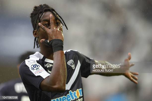 Bordeaux's French forward Yann Karamoh celebrates after scoring during the French Ligue 1 football match between Bordeaux and Nantes in Bordeaux...