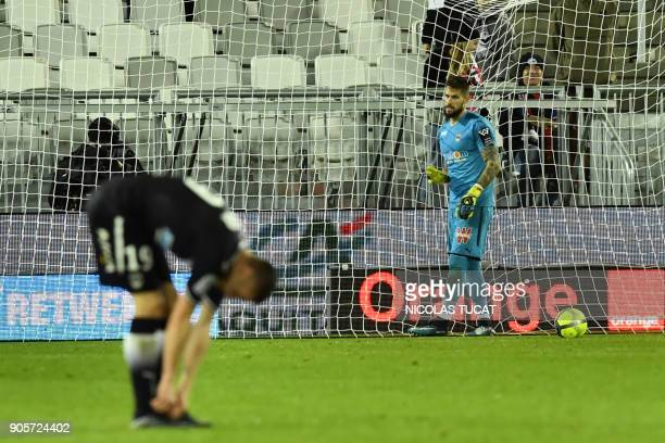 Bordeaux's French goalkeeper Benoit Costil gestures after conceding a goal during the French L1 football match between Bordeaux and Caen on January...