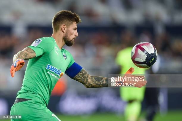 Bordeaux's French goalkeeper Benoit Costil is about to kick the ball during the French L1 football match between Bordeaux and Lille on September 26...