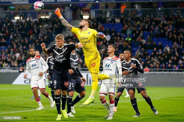 Bordeaux's French goalkeeper Benoit Costil makes a save during the French L1 football match between Olympique Lyonnais and Girondins de Bordeaux on...