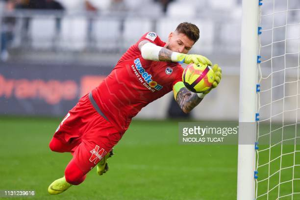Bordeaux's French goalkeeper Benoit Costil saves a goal during the French L1 football match between Girondins de Bordeaux and Rennes on March 17 2019...