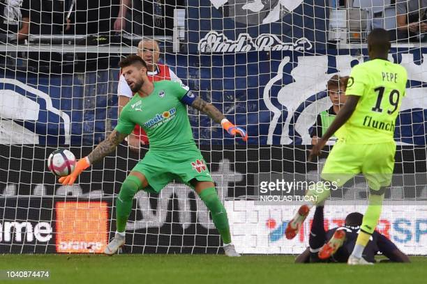 Bordeaux's French goalkeeper Benoit Costil stops the ball during the French L1 football match between Bordeaux and Lille on September 26 2018 at the...