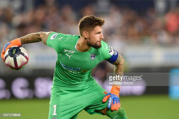 Bordeaux's French goalkeeper Benoit Costil throws the ball during the French L1 football match between Bordeaux and Lille on September 26 2018 at the...