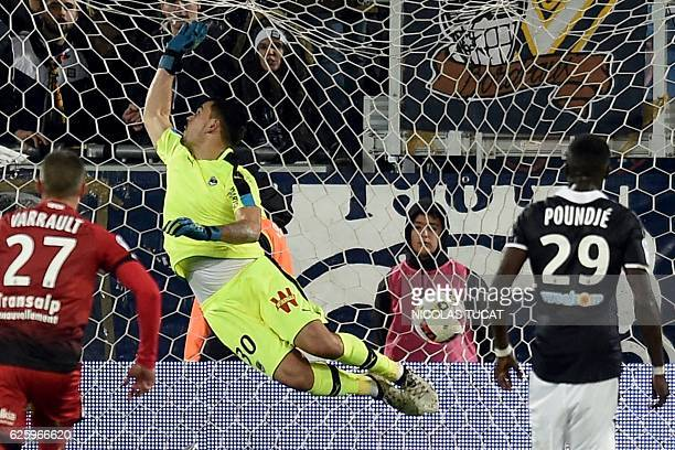 Bordeaux's French goalkeeper Jerome Prior misses the ball as Dijon's team scores during the warm up of the French Ligue 1 football match between...