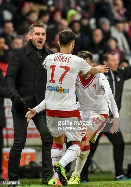 Bordeaux's French head coach Jocelyn Gourvennec reacts after FrenchAlgerian midfielder Adam Ounas scored a goal during the French L1 football match...