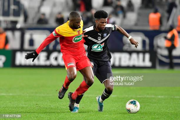 Bordeaux's French midfielder Aurelien Tchouameni vies with Le Mans' French midfielder Guessouma Fofana during the French cup football match between...