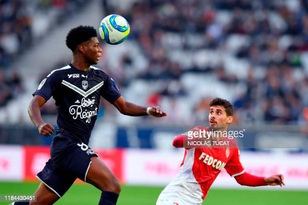 Bordeaux's French midfielder Aurelien Tchouameni vies with Monaco's Portuguese defender Gil Dias during the French L1 football match between FC...