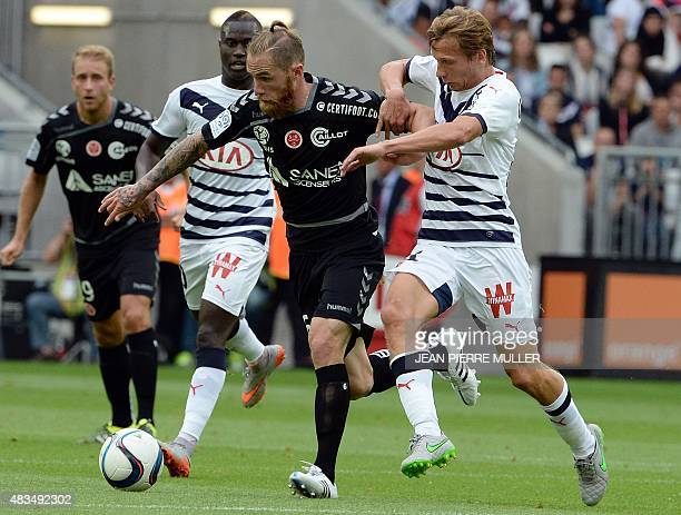 Bordeaux's French midfielder Clement Chantome challenges Reims' French midfielder Antoine Devaux during the French L1 football match between Bordeaux...