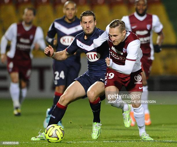 Bordeaux's French midfielder Gregory Sertic vies with Metz' Belarussian midfielder Sergei Krivets during the French L1 football match Metz against...