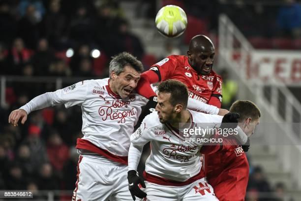 Bordeaux's French midfielder Jeremy Toulalan and Bordeaux's Serbian defender Vukasin Jovanovic vie with Dijon's Cap Verdean forward Julio Tavares and...