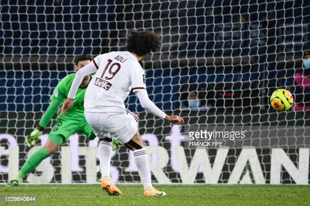 Bordeaux's French midfielder Yacine Adli shoots and scores a goal during the French L1 football match between Paris Saint-Germain and Girondins de...