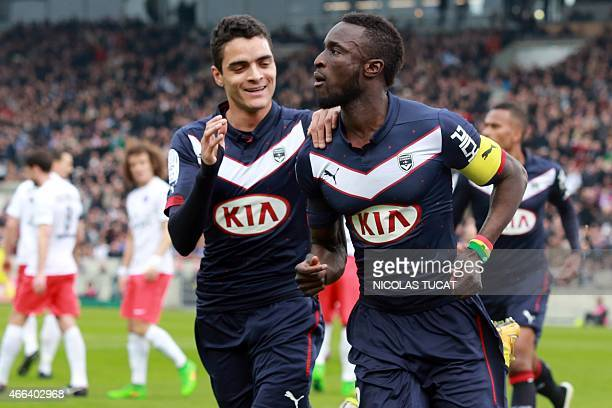 Bordeaux's French Senegalese defender Lamine Sane celebrates with a teammate after scoring a goal during the French L1 football match between...