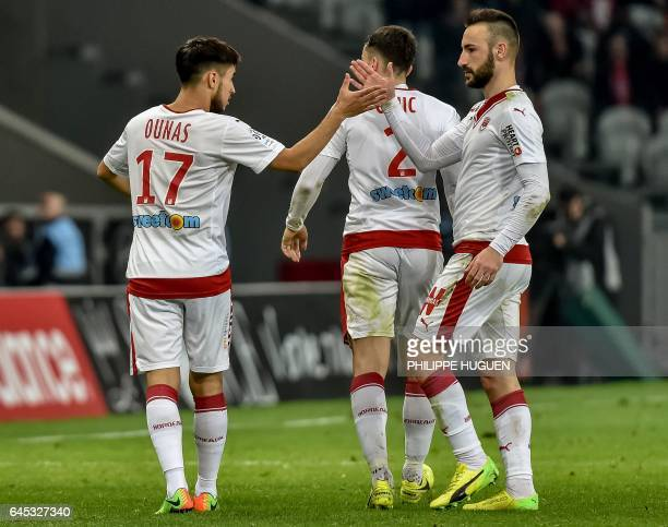 Bordeaux's FrenchAlgerian midfielder Adam Ounas is congratuled by Serbian defender Milan Gajic after scoring a goal during the French L1 football...