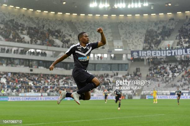 Bordeaux's Guinean forward Francois Kamano celebrates after scoring during the French Ligue 1 football match between Bordeaux and Nantes in Bordeaux...