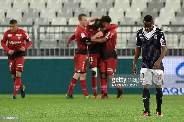 Bordeaux's Guinean forward Francois Kamano reacts as Dijon's players celebrate a goal during the French L1 football match between Bordeaux and Dijon...