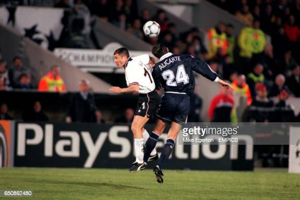 Bordeaux's Herve Alicarte beats Valencia's Adrian Ilie to a header