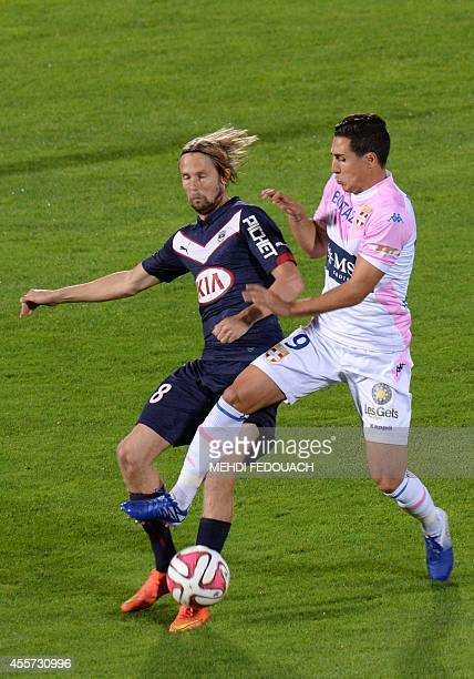 Bordeaux's Jaroslav Plasil vies with Evian's player Giani Bruno during the French L1 football match Bordeaux vs Evian on September 19 2014 at the...