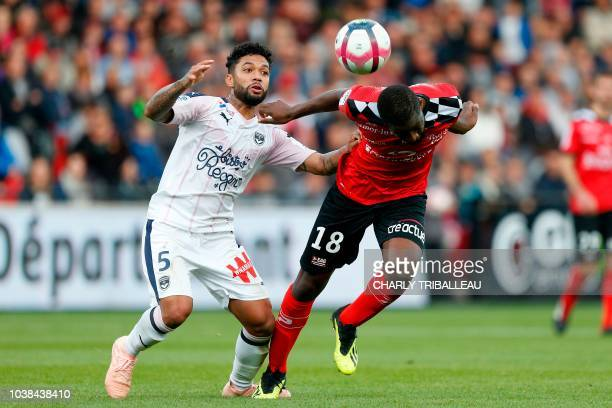 Bordeaux's midfielder Otavio Passos Santos vies for the ball with Guingamp's French midfielder Guessouma Fofana during the French L1 football match...