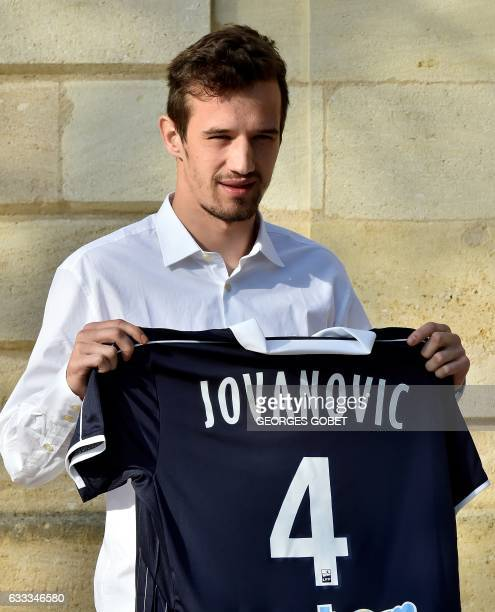 Bordeaux's new player Serbian defender Vukasin Jovanovic on transfer from FC Zenit Saint Petersburg poses with his jersey bearing the number 4 at the...
