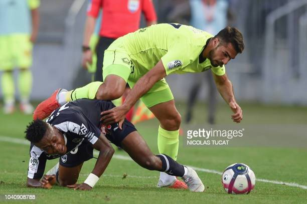 Bordeaux's Nigerian forward Samuel Kalu vies with Lille's Turkish defender Mehmet Zeki Celik during the French L1 football match between Bordeaux and...
