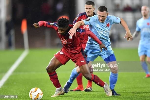 Bordeaux's Nigerian forward Samuel Kalu vies with Prague's midfielder Simon Deli during the Europa league football match of Group C between Bordeaux...