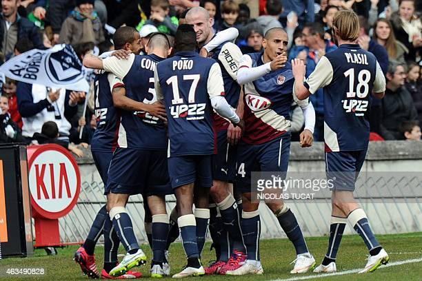 Bordeaux's players celebrate after scoring a goal during the French L1 football match between Girondins de Bordeaux and SaintEtienne on February 15...