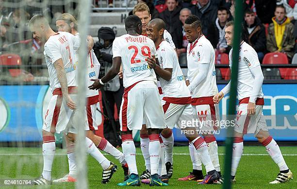 Bordeaux's players celebrate after scoring a goal during the French L1 football match between Guingamp and Bordeaux at the Roudourou Stadium in...