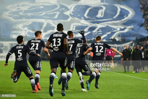 Bordeaux's players celebrate after scoring a goal during the French L1 football match between Bordeaux and Marseille on November 19 2017 at the...