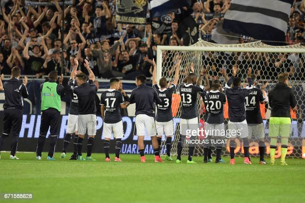 Bordeaux's players celebrate at the end of the French L1 football match between Bordeaux and Bastia on April 22 2017 at the Matmut Atlantique stadium...