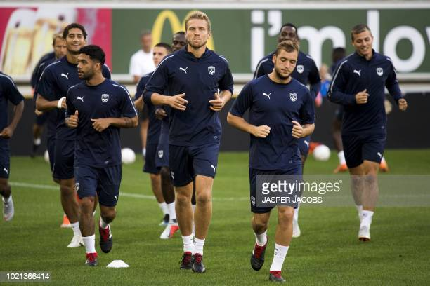 Bordeaux's players take part in a training session on August 22 2018 in Gent ahead of the UEFA Europa League first leg football match between...