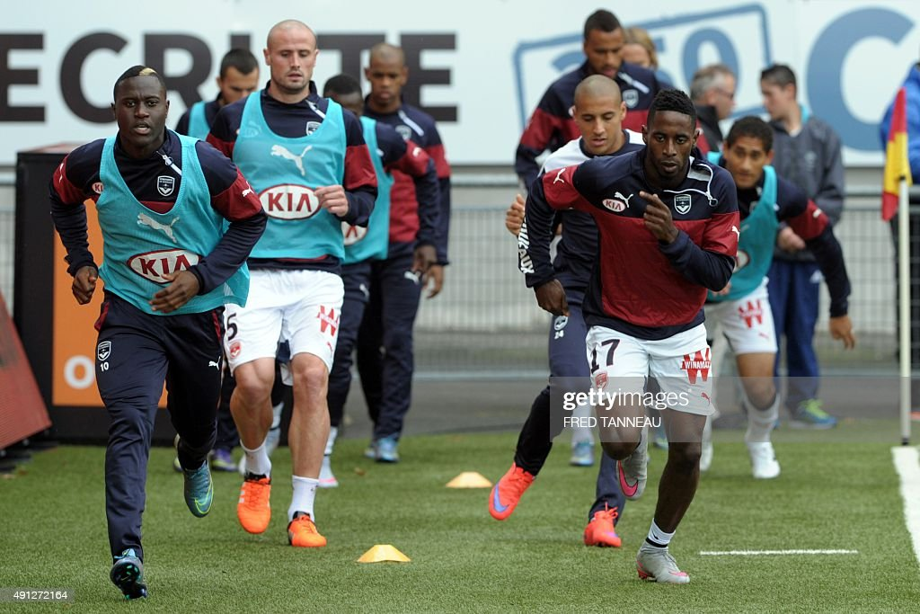 Bordeaux's players warm up ahead of the French L1 football match between Lorient and Bordeaux at Moustoir Stadium in Lorient, western France, on October 4, 2015 .