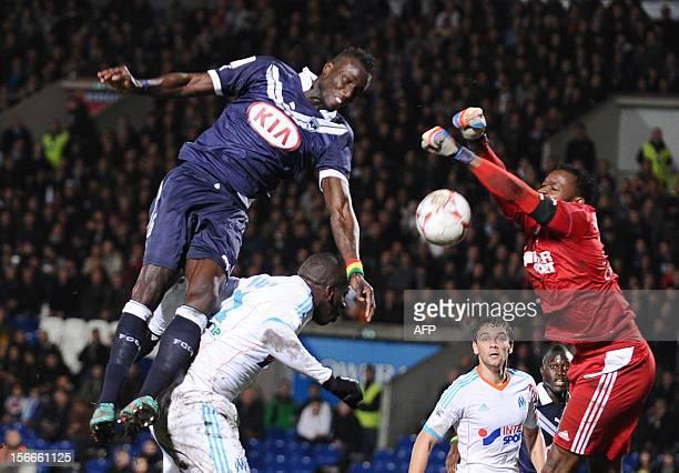 Bordeaux's Senegalese defender Lamine Sané vies with French goalkeeper Steve Mandanda during the French L1 football match Girondins de Bordeaux vs...
