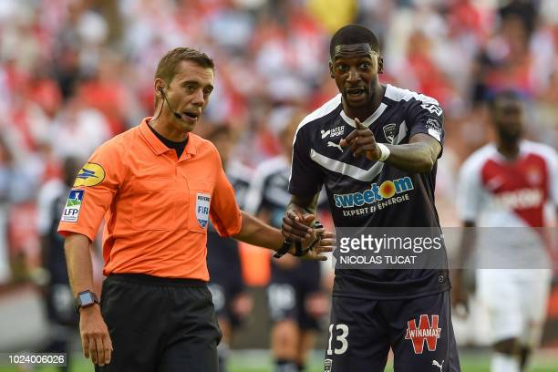 Bordeaux's Senegalese midfielder Younousse Sankhare argues with French referee Clement Turpin during the French L1 football match between Bordeaux...