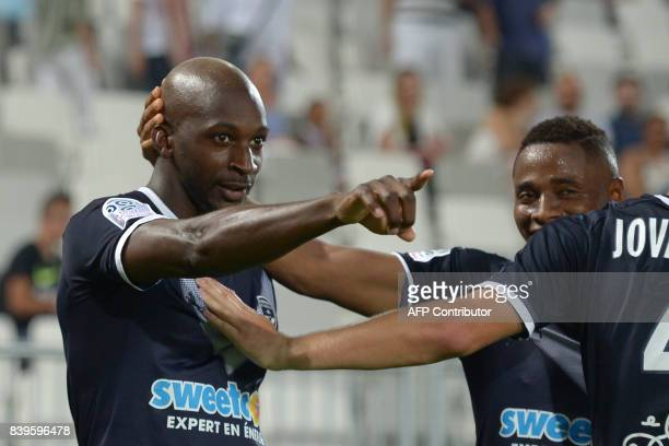 Bordeaux's Senegalese midfielder Younousse Sankhare celebrates after scoring a goal during the French L1 football match between Bordeaux and Troyes...