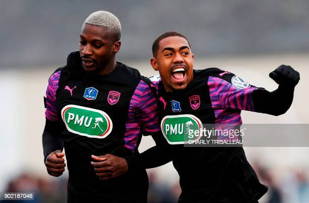 Bordeaux's Senegalese midfielder Younousse Sankhare is congratulated by Bordeaux's forward Malcom after scoring a goal during the French Cup football...