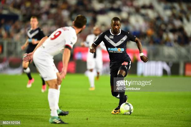 Bordeaux's Senegalese midfielder Younousse Sankhare runs with the ball during the French L1 football match between Bordeaux and Guingamp on September...
