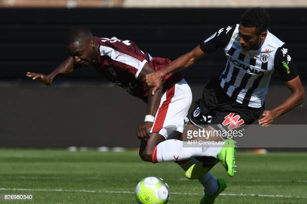 Bordeaux's Senegalese midfielder Younousse Sankhare vies for the ball with Angers' French midfielder Angelo Fulgini during the French L1 football...