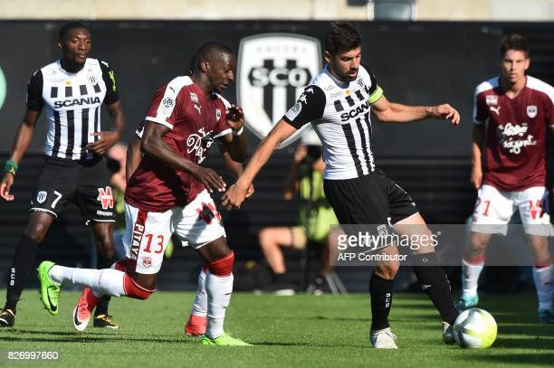 Bordeaux's Senegalese midfielder Younousse Sankhare vies for the ball with Angers' French midfielder Thomas Mangani during the French L1 football...