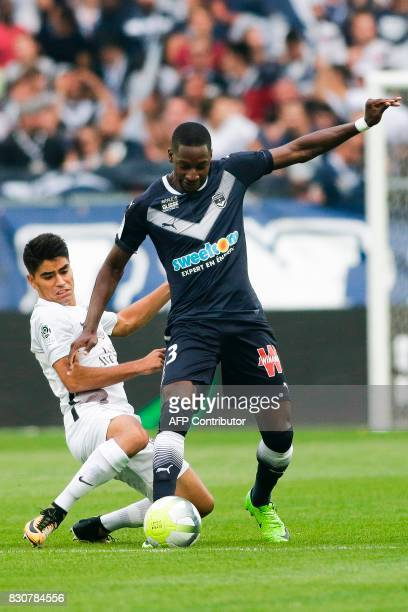Bordeaux's Senegalese midfielder Younousse Sankhare vies with Metz' Argentinian midfielder Geronimo Poblete during the French L1 football match...