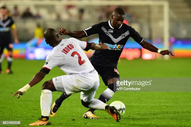Bordeaux's Senegalese midfielder Younousse Sankhare vies with Guingamp's FranchCongolese defender Jordan Ikoko during the French L1 football match...