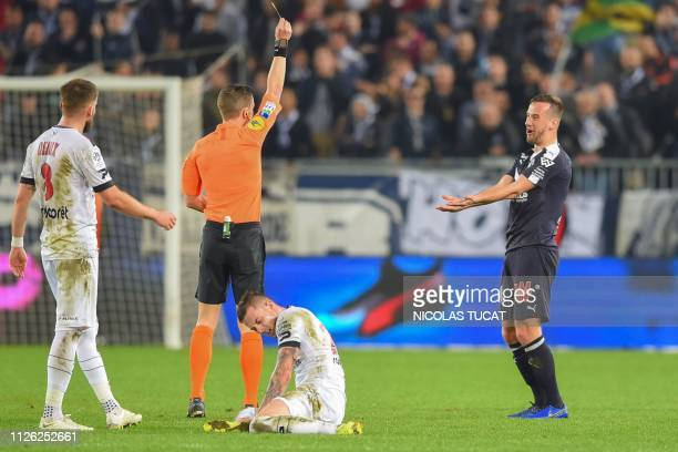 Bordeaux's Serbian defender Vukasin Jovanovic reacts as he receives a yellow card during the French L1 football match between Girondins de Bordeaux...